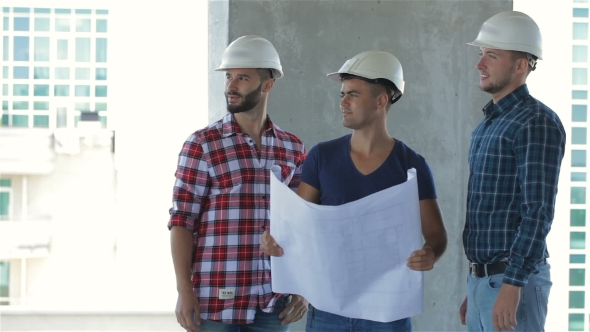 Download Three Builders Pose At The Building Under Construction nulled download