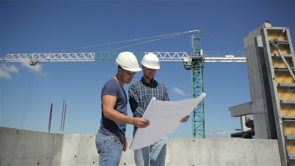 Download Construction Manager Points At The Plan Of Building Under Construction nulled download