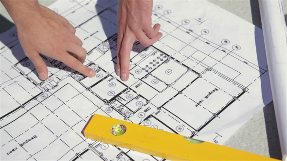 Download Male Fingers Point At The Plan Of The Building Construction nulled download