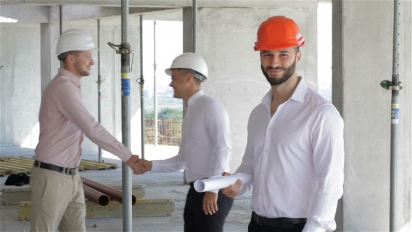 Download Male Builder Holds Set Of Plans Of Building Under Construction nulled download