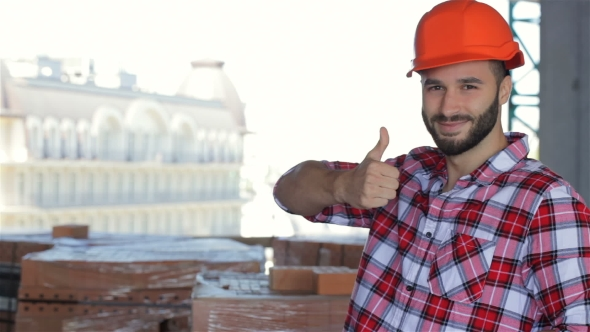 Download Male Builder Corrects His Hard Hat At The Building Under Construction nulled download
