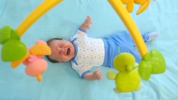 Download Little Cute Baby Boy Lying In Crib With Toy nulled download