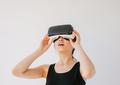 Asian woman using the virtual reality headset