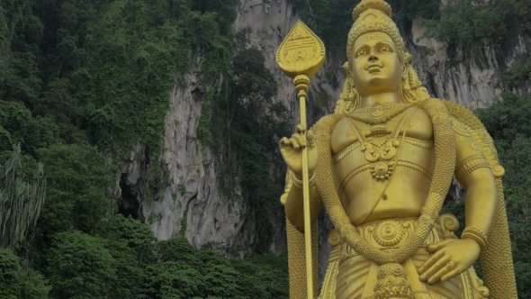 Download Murugan Statue Against Limestone Hill. Batu Caves, Malaysia nulled download