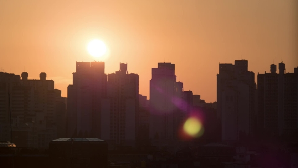 Download Sun Rising and Moving in the Sky, City Modern Buildings on the Foreground. Seoul, South nulled download
