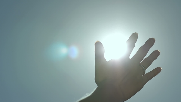 Download Abstract Sun Rays Through Female Fingers Palm nulled download