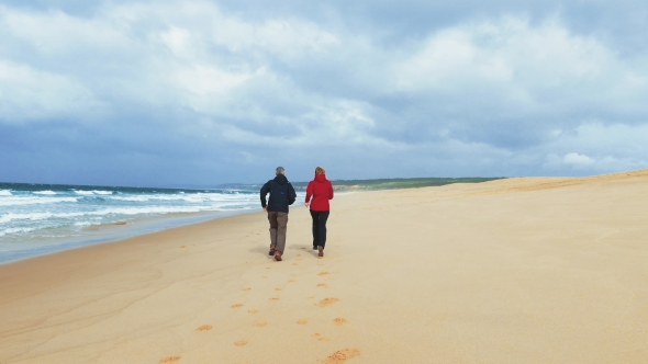 Download Middle-aged Couple Jogging On Beach nulled download