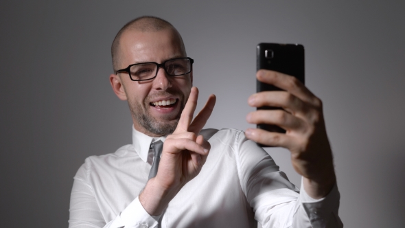 Download Funny Businessman Manager Makes Selfie Phone. nulled download