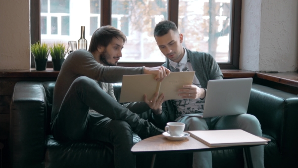 Download Two Entrepreneurs Working And Taking Notes nulled download