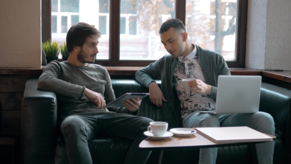 Download Two Entrepreneurs Working And Taking Notes Together In Table Of Little Office. Freelancer Meeting nulled download