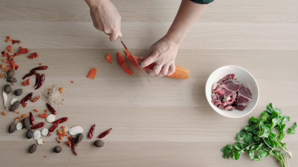 Download Top View Of Chefs Hands Chopping Carrot On Wooden Board, Healthy Food Concept nulled download