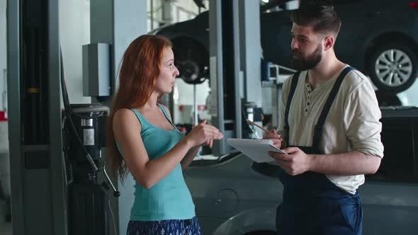 VideoHive Female Customer in Car Service Center 19662812