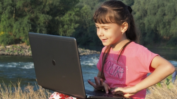 Download Girl With a Laptop Near a River nulled download