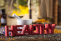 Healthy herbs on wooden table, mortar and herbal medicine