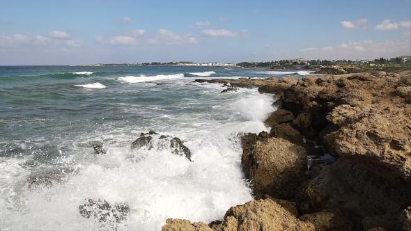 Download Waves Breaking Against Rocks On Sea Shoreline. nulled download