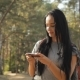 Female Hiker Uses Maps In Her Smartphone