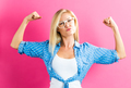 Strong young woman on pink background