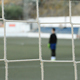 Children Goalkeeper in a Football Game Behind the Goal