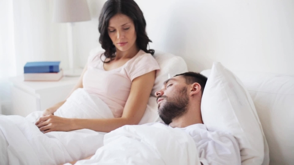 Download Angry Woman Waking Man Sleeping In Bed nulled download