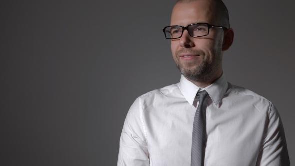 Download Portrait Of Handsome Businessman Standing On Grey Background nulled download