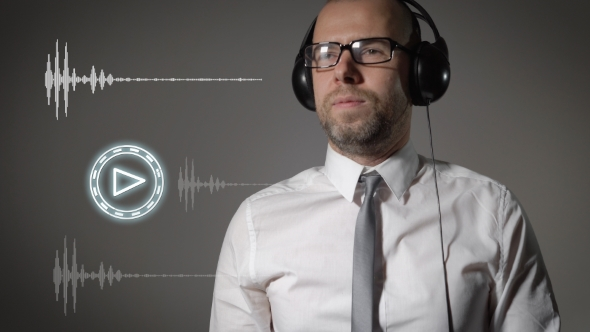 Download Businessman In a Shirt And Big Headphones, Click On The Play Button And Start Listening To Music. nulled download