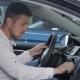 Man Examines Car Interior At The Dealership