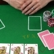 Poker Player Looking At Her Cards And Folds. Concept Of Gambling, Risk, Luck, Win, Fun