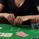 Poker Player Looking At Her Cards And Folds