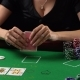 Poker Player Looking at her Cards and Checks. Concept of Gambling, Risk, Luck, Win, Fun and Entertai