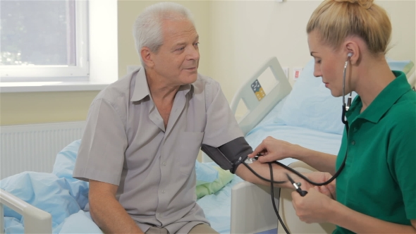 Download Nurse Measures Blood Pressure Of Male Patient nulled download