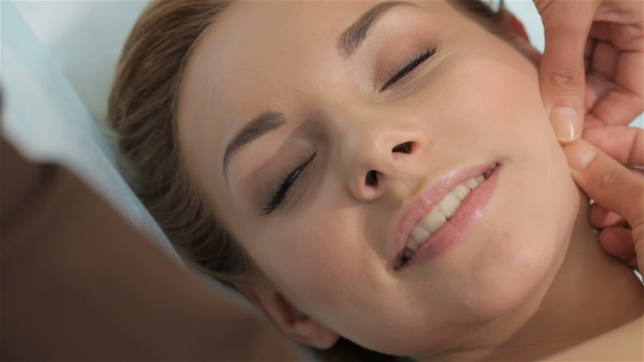 Download Massage Specialist Makes Skin Lifting Massage To The Client nulled download