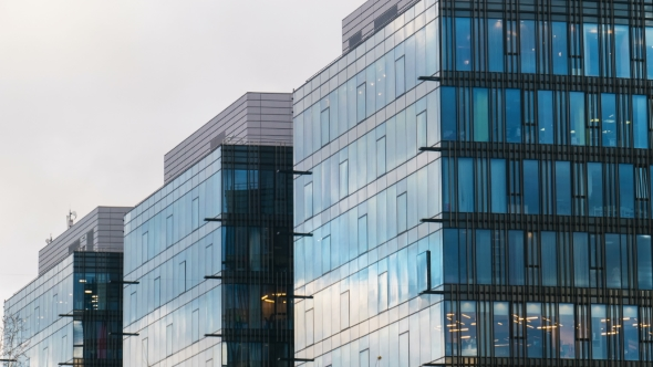 Download Office Building Skyscraper in the Windows of which reflected the passing clouds nulled download