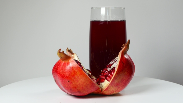 Download Pomegranate Juice In a Glass And Ripe Pomegranate nulled download