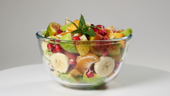 Download A Fruit Salad With Mandarin, Oranges, Kiwi, Pomegranate Seeds, Figs, Banana And Peaches nulled download