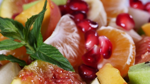 Download Fruit Salad With Mandarin, Oranges, Kiwi, Pomegranate Seeds, Figs, Banana and Peaches nulled download