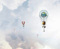 Aerostats flying high . Mixed media