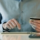 Man Using Credit Card And Tablet For Online Shopping