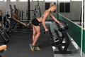 Fitness Woman Doing Exercise For Back With Dumbbells