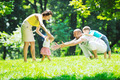 happy young couple with their children have fun at park - PhotoDune Item for Sale