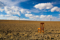 Old wooden chair on the empty field