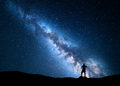 Milky Way and silhouette of alone man. Night landscape