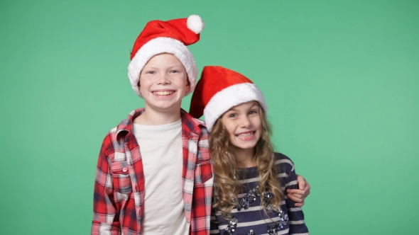 Couple Of Children In Christmas Caps