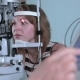 Modern Medical Procedure. Ophthalmologist Points At Touchscreen During Eye Examining.