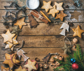 Cookies, nuts, spices, wooden angels and fir branch with balls