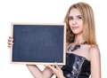 Young woman holding empty chalkboard