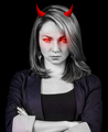 Angry woman with red eyes and devil horns