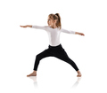 Little cute girl doing yoga exercises