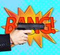 Handgun over retro cartoon explosion