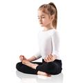 Little girl meditating in lotus position