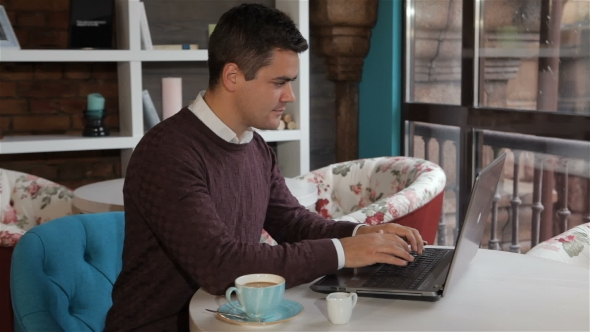 Download Man Uses Laptop At The Cafe nulled download